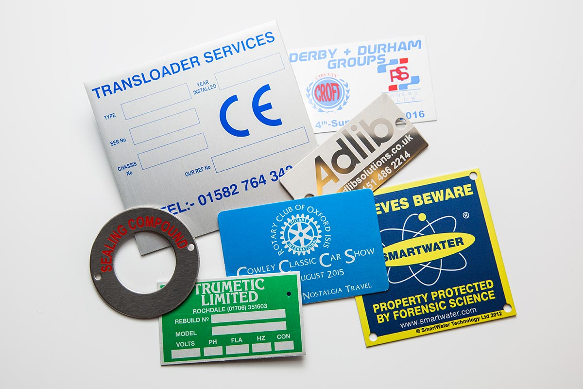 several colour custom metal labels of varying shapes and sizes