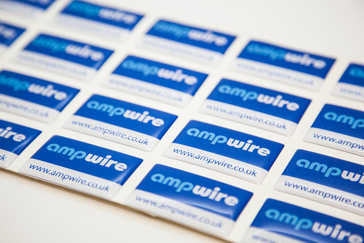 sheet of blue and white domed labels