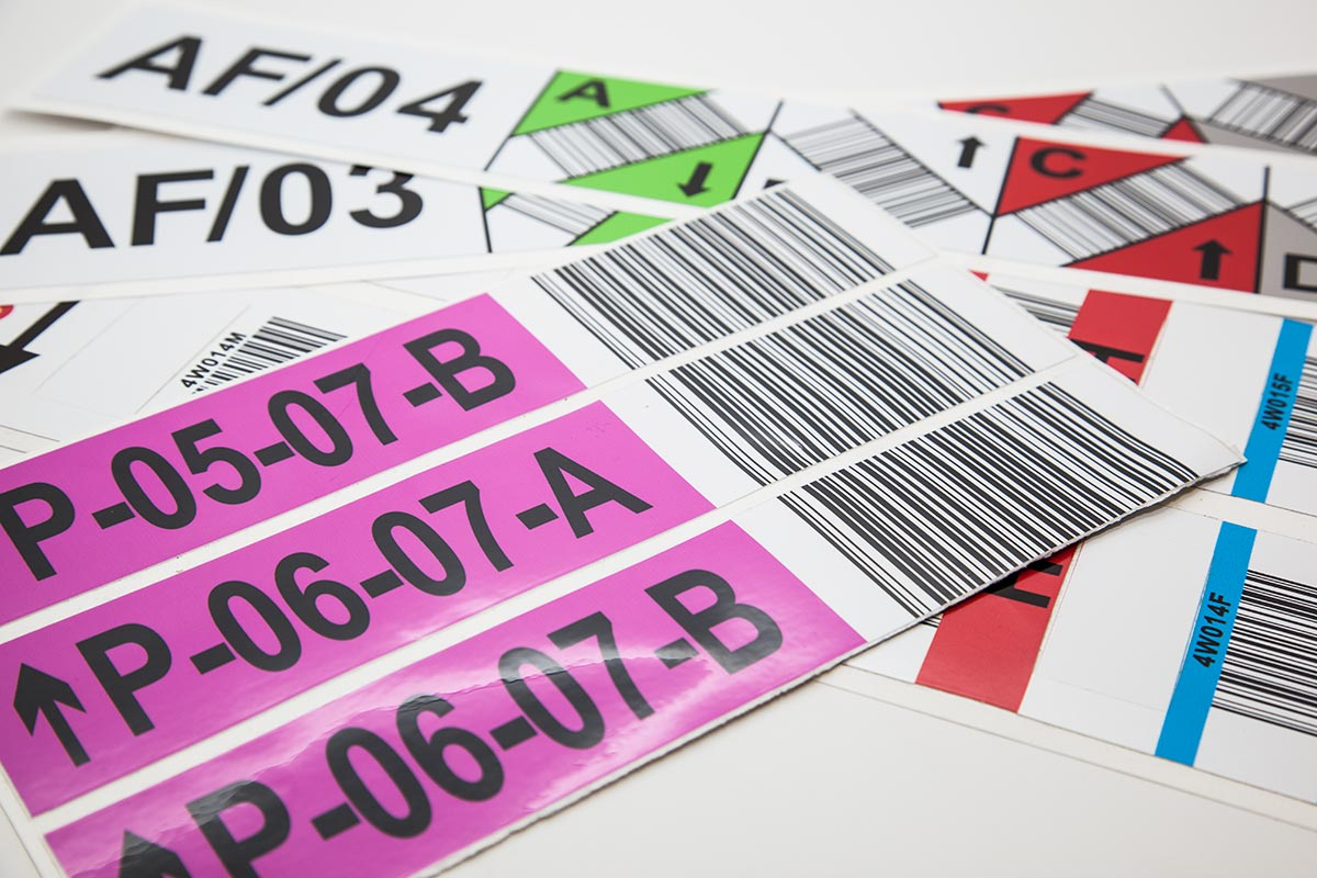 several sheets of full colour stocking and barcode laminated labels
